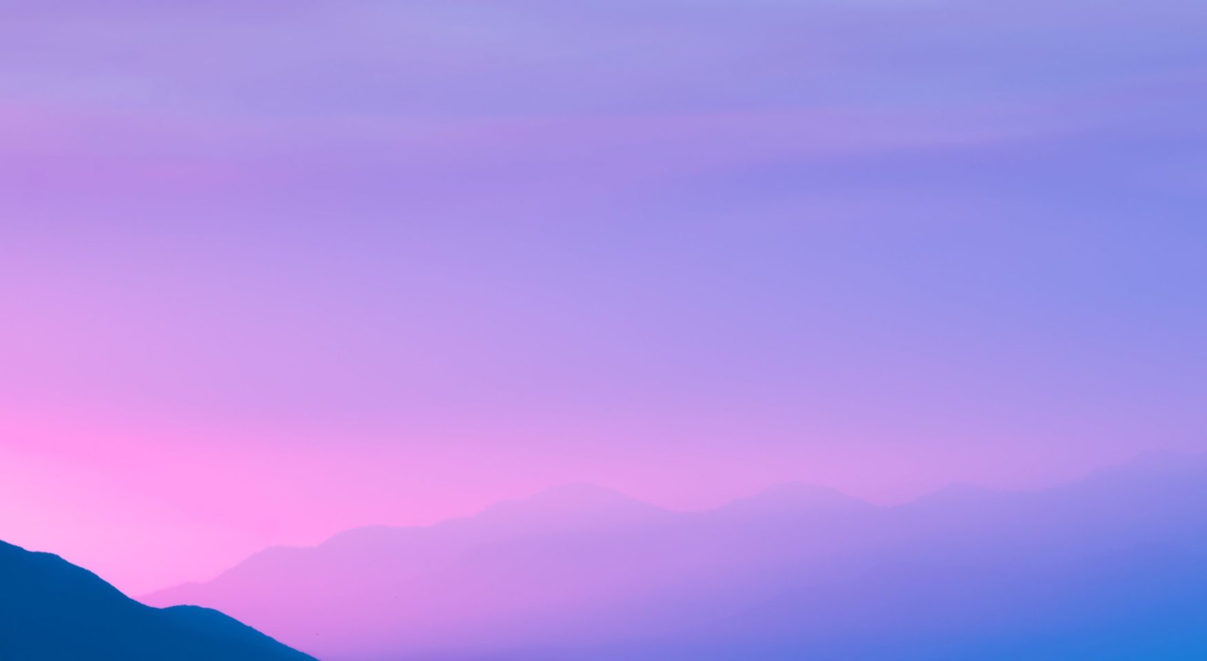 Brilliant purple pink sky over mountains