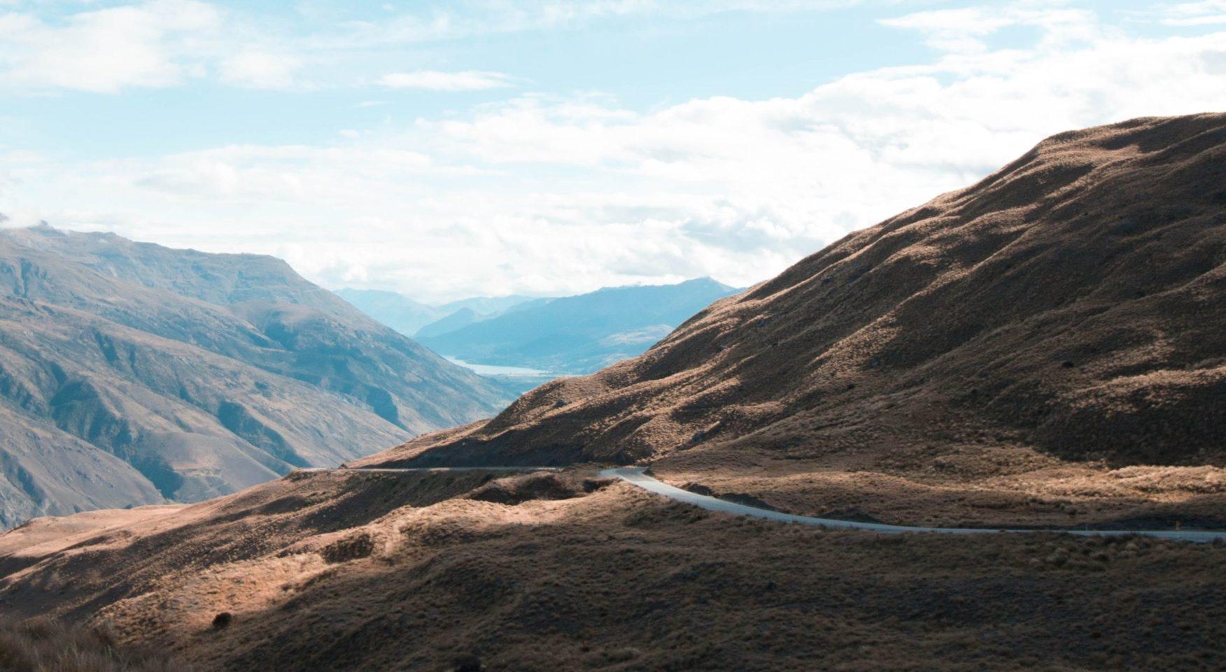 Road winding through brown mountains