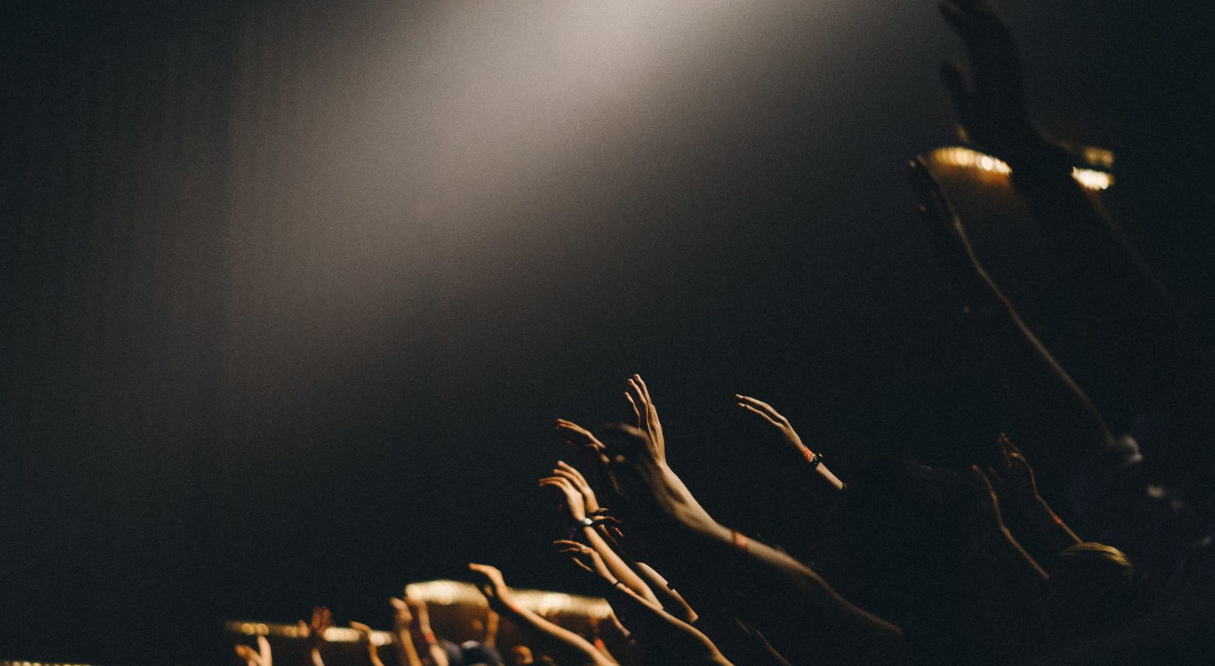 People worshipping in a dark room