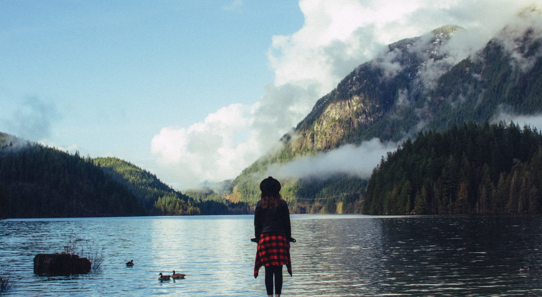 girl-plaid-gazing-water-mountains