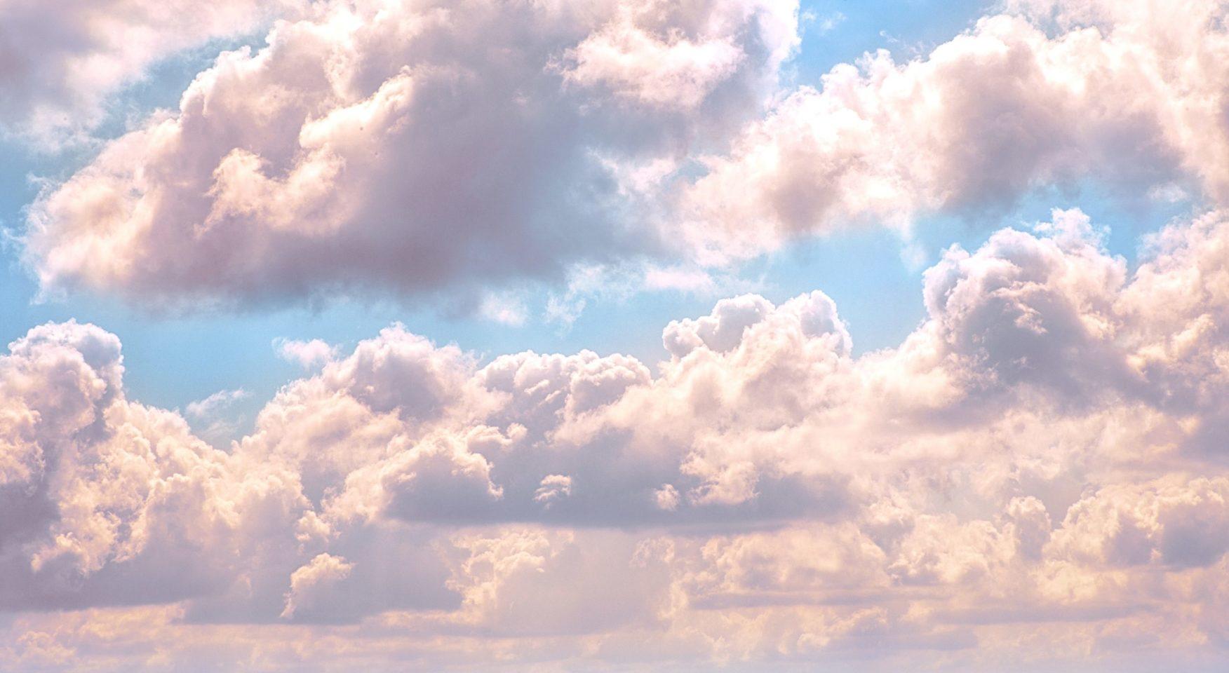 Luminous clouds set against a sunny sky
