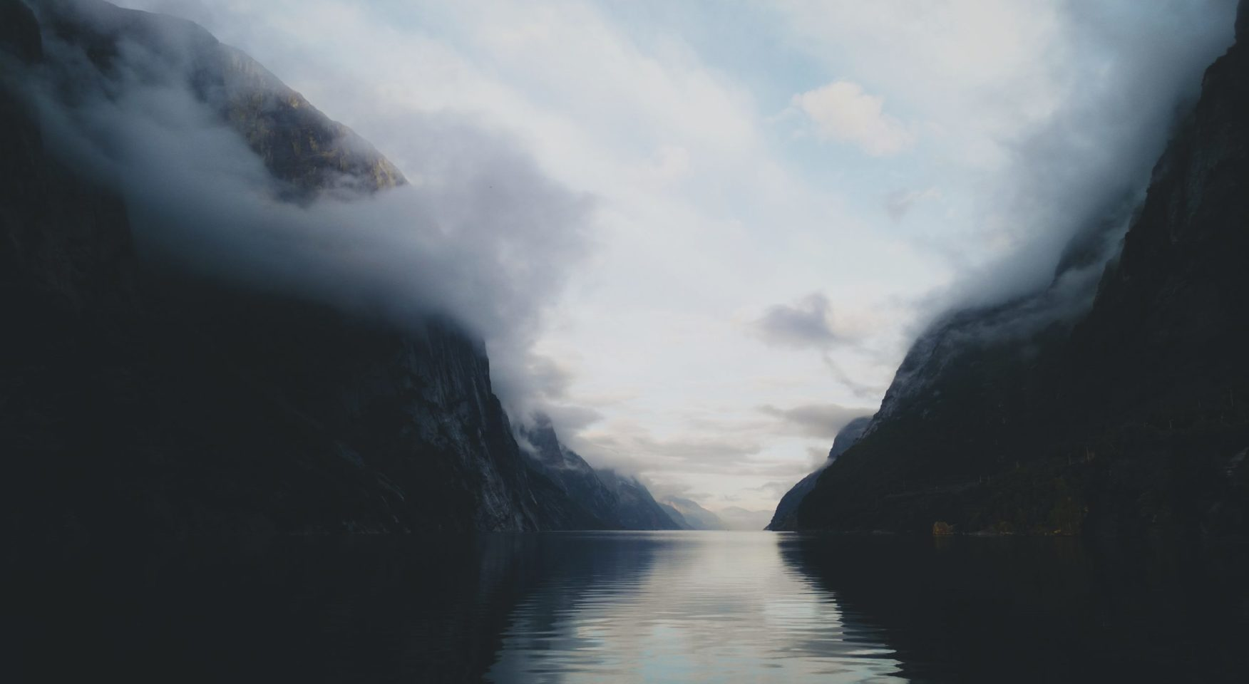 River winding through misty mountain pass